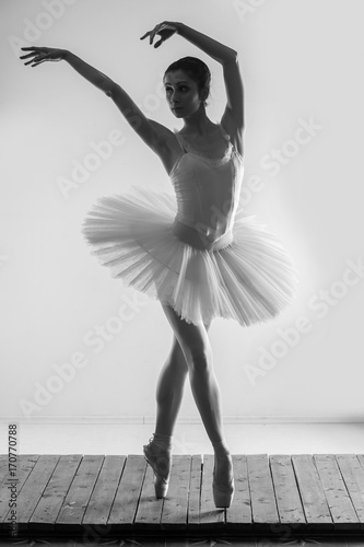 Ballerina dancing in studio - 170770788