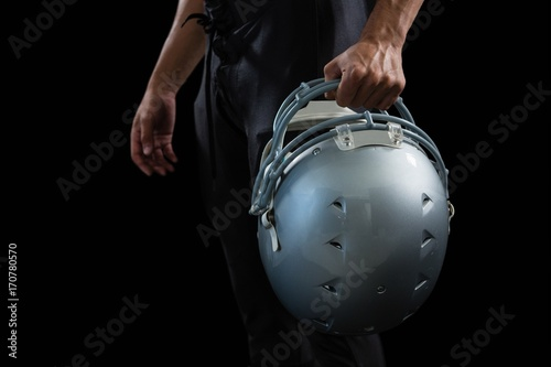 American football player holding a head gear