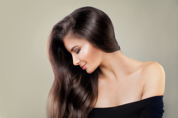 Cute Model Woman with Shiny Hairstyle and Makeup, Beauty Salon or Barber Shop Background. Pretty Fashion Girl with Long Healthy Hair