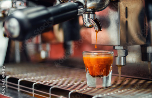 glass of fresh espresso with a falling drop in it Poster