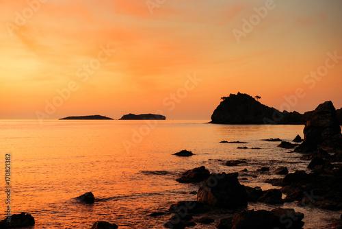 Papiers peints Orange eclat orange sunset over the sea