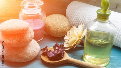 Foto op Plexiglas Spa Aromatic candle and spa stones and massage oil and towel concept spa treatments
