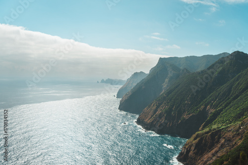 Fotobehang Pool View of Madeira rocky coastline and vibrant mountains
