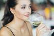 Beautiful woman tasting wine
