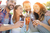 Group of friends gathering in bar drinking beers - 170842176