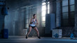 Fit Athletic Woman Does Footwork Running Drill in a Deserted Factory Remodeled into Gym. Cross Fitness Exercise/ Workout Aimed at Strengthening Legs, Enhancing Her Agility and Speed.