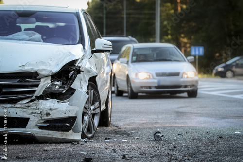 Front of a car get damaged by crash accident on the road Poster