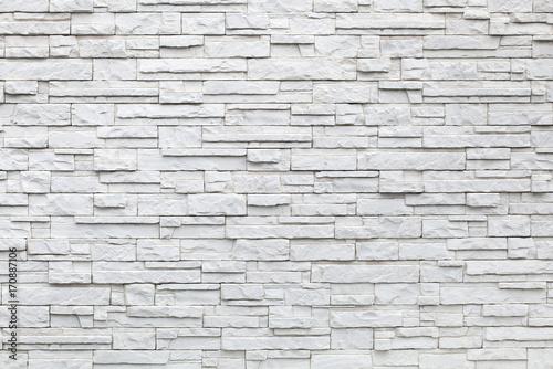 Fototapeta Background of white stones, decorative wall surface