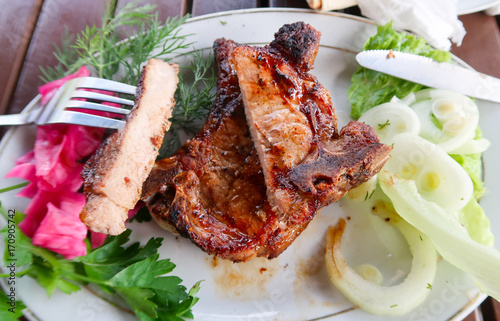 Foto op Plexiglas Steakhouse Meat steak on a plate fork knife