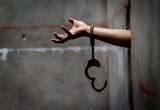 Man prisoners with shackle are trapped in the dungeons is asking for help. - 170916347