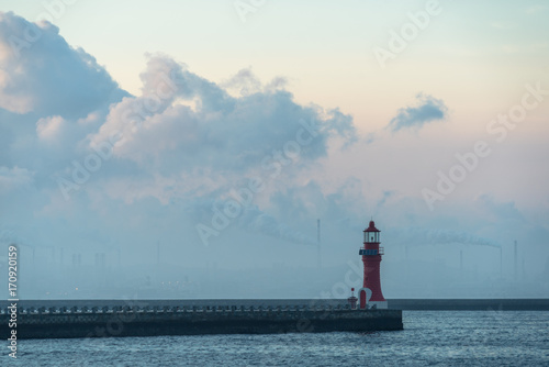 Aluminium Vuurtoren lighthouse against cloudy sky,dalian city,china.