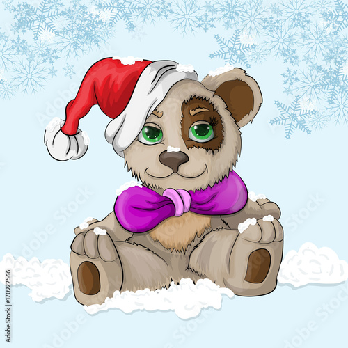 sitting little bear cub on the snow in a Christmas hat