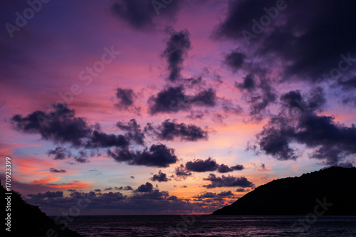 Foto op Canvas Aubergine Sunset with dramatic sky ,clouds over mountain and andaman sea at phuket thailand