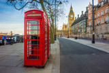 London, England - Traditional Old British red telephone box at Victoria Embankment with Big Ben at background - 170923720