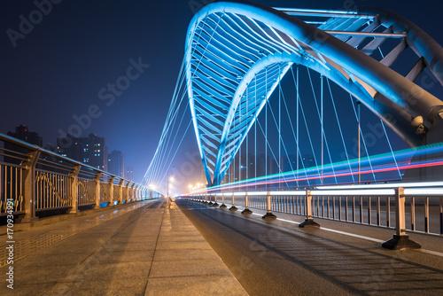 In de dag Tunnel suzhou bridge road landscape at night,China.