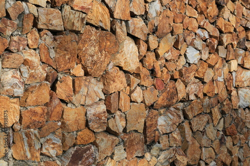 Fotobehang Stenen Brown stone surface of wall background.