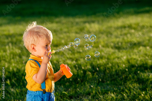 Papiers peints Kiev One year old baby boy blowing soap bubbles