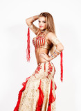 Arabic dance performed by a beautiful plump woman on a light background