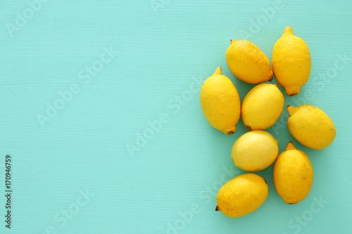 Fotobehang Pop Art Top view of fresh lemons over blue wooden background