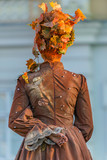 Living statue of a woman dressed with autumn elements - 170972126