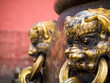 Closeup of Brass lion heads decorating ancient Chinese water urn in Forbidden City lio
