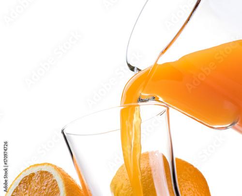 Foto op Plexiglas Sap Pouring refreshing orange juice into a glass