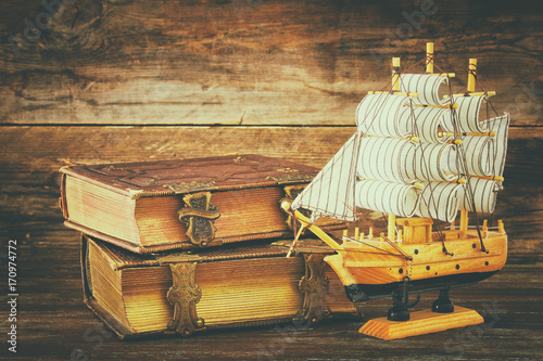 Fotobehang Schip Columbus day concept with old ship over wooden background