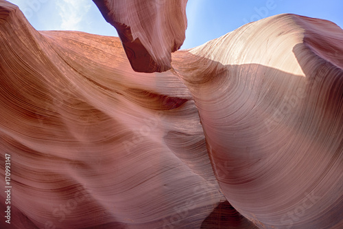 Fotobehang Diepbruine Lower Antelope Canyon was formed by erosion of Navajo Sandstone, primarily due to flash flooding and secondarily due to other sub-aerial processes.