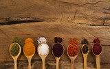 Oriental various spices in wooden spoons