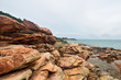 The rocks are arrange at the seacoast.