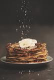 Homemade pancakes with fresh bananas and honey