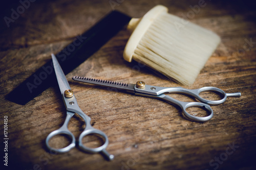 Fototapeta hairdresser tools on wooden table