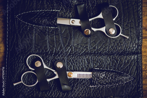 hairdresser tools on wooden table Poster