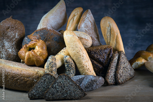 Different bread and bread slices. Food background. Poster