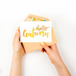 Woman holding a empty card and pink envelope. Beautiful spring mock up.  Flat lay, top view