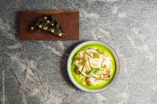 Aluminium Barcelona Haute cuisine, Gourmet appetizer, squid, black tempura, asparagus and mushrooms polenta