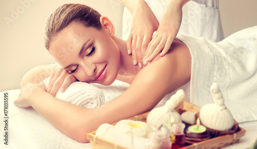 Aluminium Spa Massage and body care. Spa body massage treatment. Woman having massage in the spa salon for beautiful girl