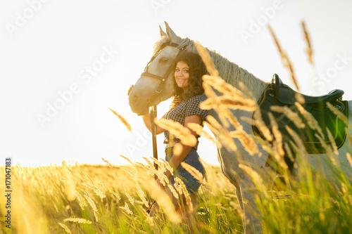 beauty brunette woman with horse