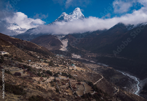 Ama Dablam and Nepalese village in Himalayas Poster