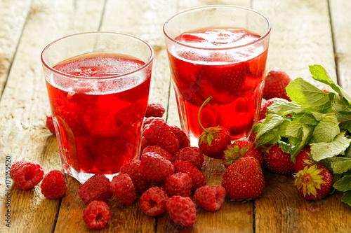 Fotobehang Sap Glasses of refreshing drink with berries