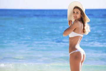 Woman in bikini near sea