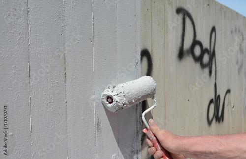 Fotobehang Graffiti schmiererei übermalen