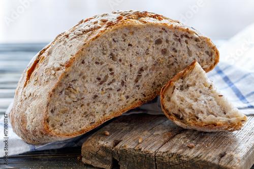 Fototapeta Bread with seeds of flax, sunflower, sesame and pumpkin.
