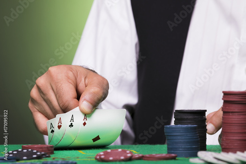 Plakat Poker player holding four aces cards in hand