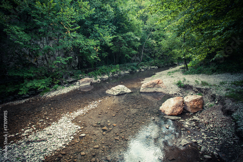 Aluminium Bergrivier small mountain river with lot of stones and rocks