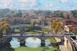 bridge Ponte Vittorio II with Tiber river and cityscape of Rome, Italy
