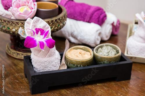 Foto op Plexiglas Spa Aroma oil, facial cream, powder, towel on table, spa concept