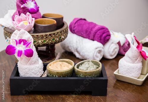 Fotobehang Spa Aroma oil, facial cream, powder, towel on table, spa concept