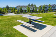 Recreation area with chess table on the block of new townhouses