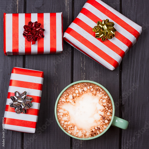 Foto op Plexiglas Chocolade cup of hot cocoa or chocolate with marshmallow and gift boxes